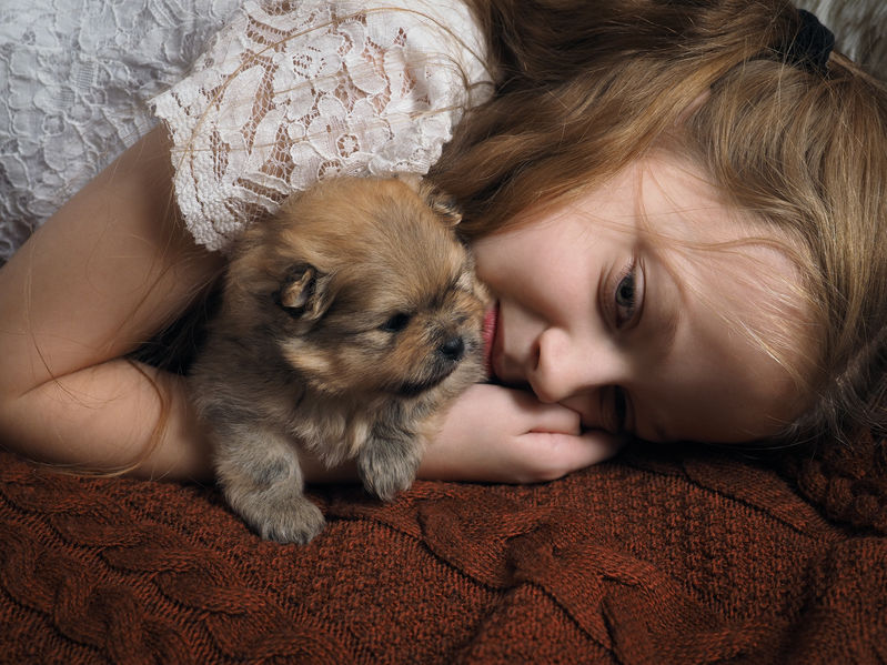 girl-resting-with-pup.png